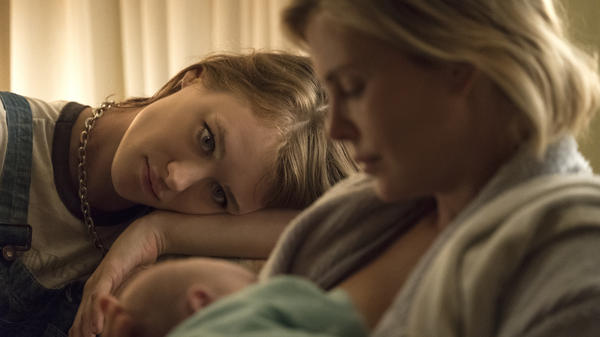 A night nanny (Mackenzie Davis) and a harried mother (Charlize Theron) develop an unusual relationship in <em>Tully. </em>