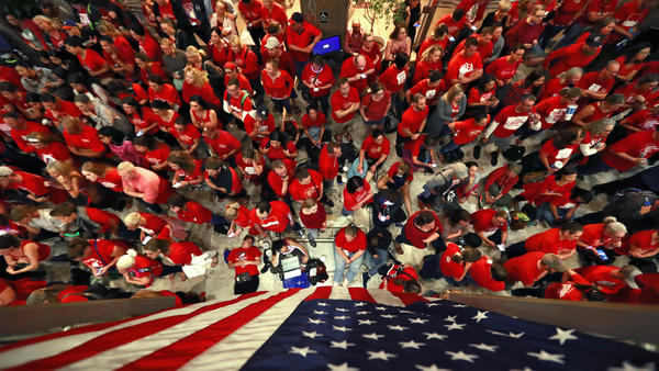 Teachers packed the lobby of the Arizona Capitol in Phoenix in the wee hours of Thursday morning, as lawmakers debated a budget that gives teachers big raises but falls short of their demands for better school funding.
