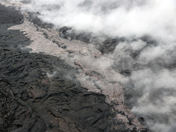 Telephoto view of a small lava flow (lighter in color) and spatter (blue-gray) that were erupted from a section of the crack on the west flank of Pu'u O'o on May 1.