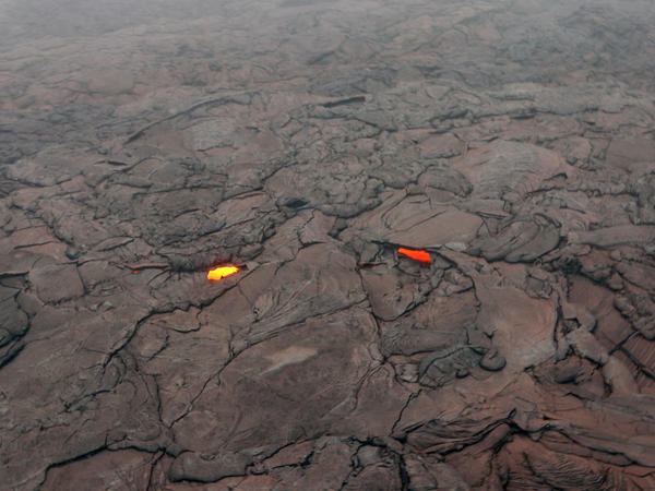 The collapse of the Pu'u O'o crater floor April 30 produced a large amount of red ash that was deposited around the crater and blown farther downwind.