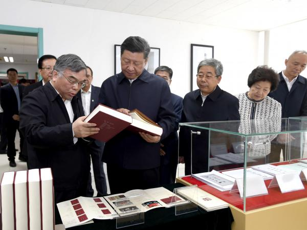Chinese President Xi Jinping visits the Marxist literature center at Peking University, long a bastion of patriotic student activism, in Beijing on Wednesday. Xi has pushed China's universities to enforce ideological conformity and avoid discussing constitutional democracy, civil society and judicial independence.
