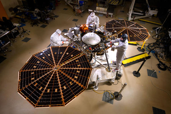 NASA's InSight Mars lander sits with its solar arrays deployed in a Lockheed Martin clean room near Denver.