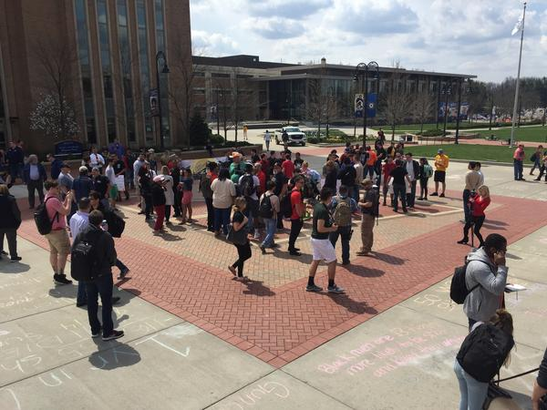 Open carry demonstrators gather at Risman Plaza.