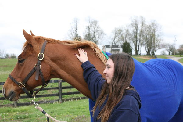 Allie Johnson, a rising Midway junior, with her favorite ride, Sophie.