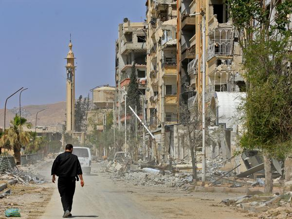 A man walks down a street in war-torn Douma on April 20, days after the suspected chemical attack.