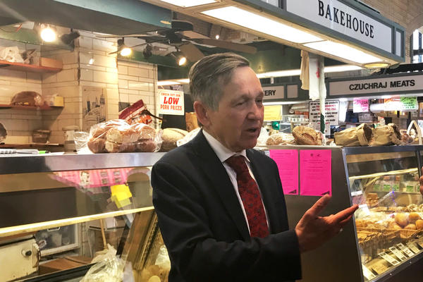 Dennis Kucinich greets voters at the West Side Market in Cleveland. He surprised voters and his opponents with his late candidacy for governor.