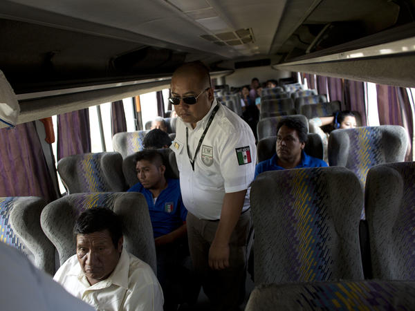 An immigration official checks a bus for Central American migrants at a roadblock north of Arriaga, Chiapas state, Mexico. In recent years the country has apprehended and deported more Central American migrants than the U.S. has.