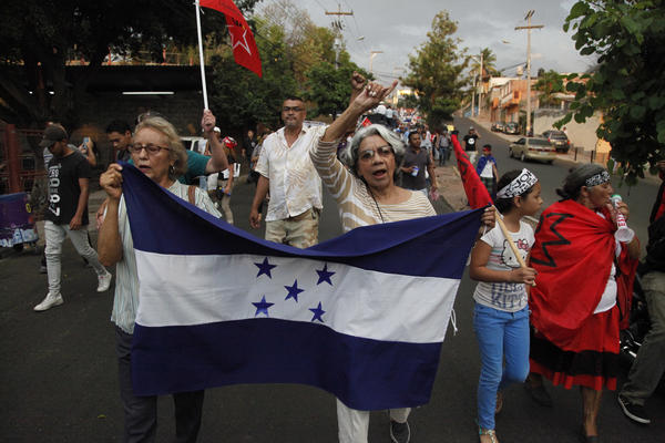 "Members of the opposition to the administration of Honduran President Juan Orlando Hernandez march on Friday to protest the U.S. government's decision to end the Temporary Protected Status designation for nearly 57,000 people from Honduras. Hernandez called the decision a sovereign issue for Washington, adding that ""we deeply lament it."""