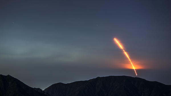 The Atlas V rocket carrying the Mars InSight lander launches from Vandenberg Air Force Base, as seen from the San Gabriel Mountains more than 100 miles away, on Saturday morning. The InSight probe is the first NASA lander designed entirely to study the deep interior structure of Mars.