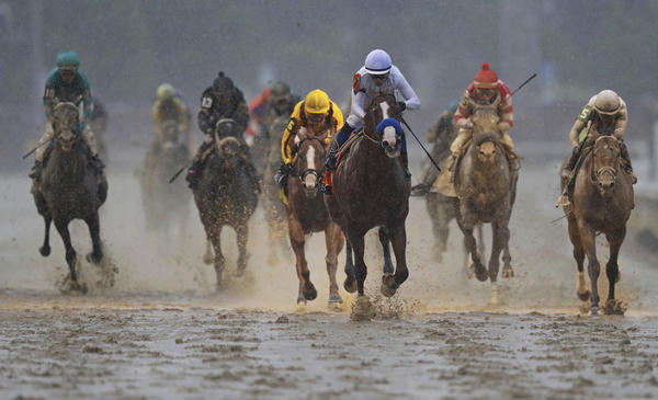 Mike Smith rides Justify to victory during the 144th running of the Kentucky Derby at Churchill Downs on Saturday, in Louisville, Ky.