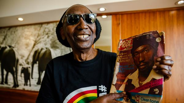 Thomas Mapfumo, holding a copy of a July 1984 edition of a magazine featuring his cover story. After 18 years in self-imposed exile, one of Zimbabwe's most popular and outspoken musicians, has returned home.