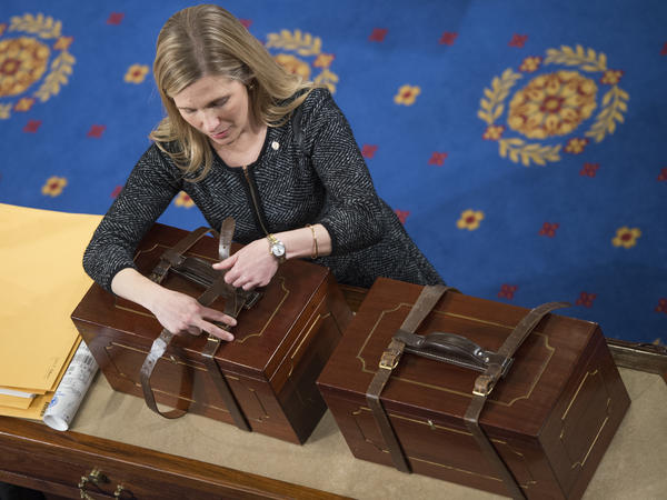 Connecticut is the latest state to pledge its electoral votes based on the outcome of the national popular vote. Here, an aide opens Electoral College ballot boxes during a joint session of Congress in January of 2017, to tally ballots for the president and vice president of the United States.