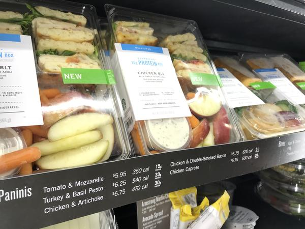 Signs declare the calorie counts for sandwiches and other grab-and-go items at a Starbucks in Washington, D.C.