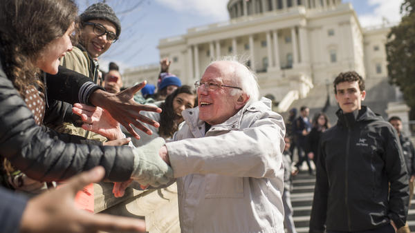 Onetime presidential candidate Sen. Bernie Sanders, I-Vt., visits protesters at a March rally at the Capitol during a national walkout by students calling on Congress to act on gun violence prevention.