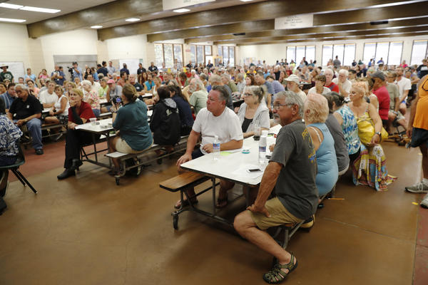 Residents from the lava-affected areas attend a community meeting at Pahoa High School in Pahoa on Friday.