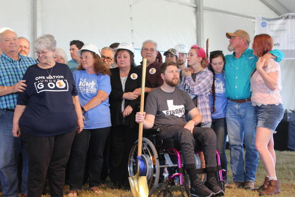 Kris Workman (in wheelchair), who was shot at the Sutherland Springs First Baptist Church on Nov. 5, and other survivors and victims' relatives prepare to break ground on a new church Saturday.