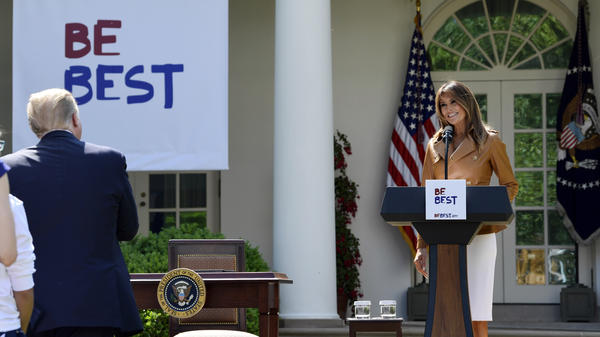 First lady Melania Trump looks at President Donald Trump as she arrives for an event where she announced her initiatives in the Rose Garden of the White House Monday.