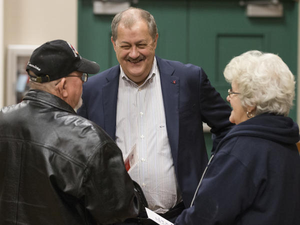 Former Massey CEO and West Virginia Republican senatorial candidate Don Blankenship (center) greets supporters Doug Smith and Wanda Smith prior to a town hall in Logan, W.Va., on Jan. 18.