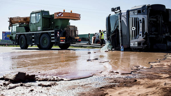 An overturned tanker full of chocolate spills its goods across a highway outside Slupca, Poland.