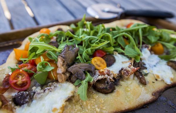Kathy's mushroom, prosciutto, mozzarella and arugula pizza. (Jesse Costa/WBUR)