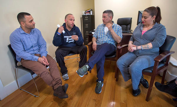 From left to right: Felito Diaz, Julio Cesar Santiago, Richard Lopez and Irma Bermudez meet at Casa Esperanza, a treatment and transitional housing program in Roxbury, Mass.