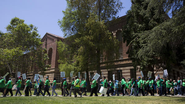 Protesters march on the UCLA campus Monday in Los Angeles, demanding solutions to gender pay inequity and higher wages. It was the first of three days of walkouts by service workers at University of California campuses.