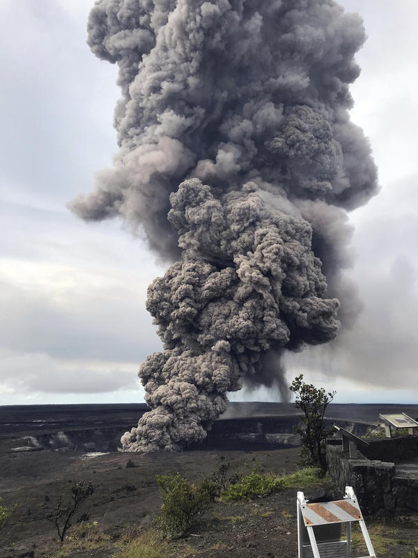 An ash column rises from the overlook at Halema'uma'u Crater at the summit of Kilauea volcano in Hawaii Volcanoes National Park on Wednesday morning.