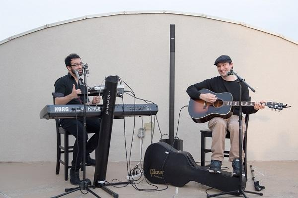 Chris Hendricks and Andre Dimuzio of the band 'Castle Wild' perform at a house concert.