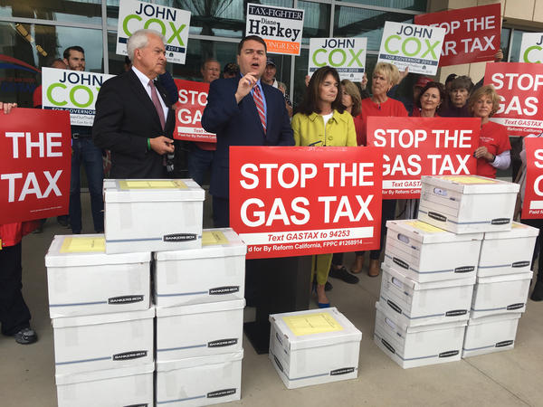 Republican gubernatorial candidate John Cox (left) and organizer Carl DeMaio (center) lead a petition drive last month to repeal California's gas taxes and vehicle registration fees.