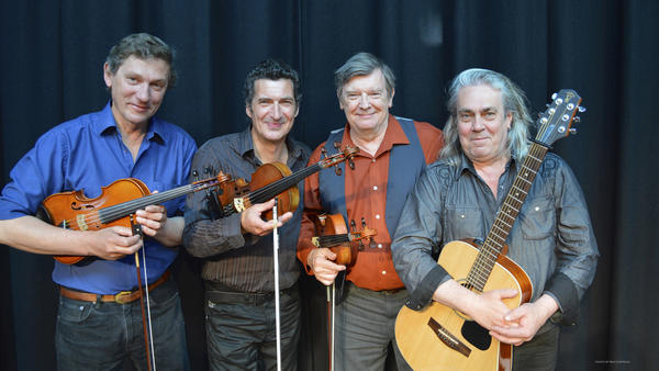 Musicians Nicolas Quemener, Kevin Burke, Christian Lemaître and Charlie McKerron at The Celtic Fiddle Festival.