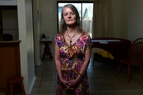 "Eleven days after surgery on her shoulder and foot, Sherry Young of Lawton, Okla., got a letter from her insurance plan saying that it hadn't approved her hospital stay. The letter ""put me in a panic,"" says Young. The $115,000-plus bill for the hospital stay was about how much Young's home is worth, and five times her annual income."