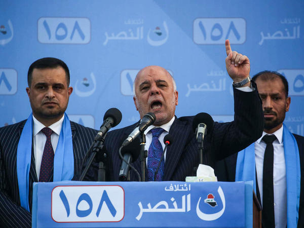 Iraqi Prime Minister Haider al-Abadi speaks at a campaign rally in Karbala on May 4.