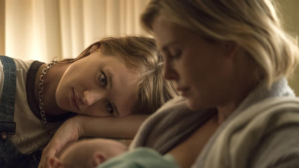 Mackenzie Davis as Tully and Charlize Theron as Marlo in <em>Tully</em>.