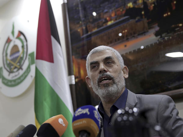"Yehiyeh Sinwar, the Hamas militant group's leader in the Gaza Strip, speaks to foreign correspondents in his office in Gaza City on Thursday. ""What's the problem with hundreds of thousands breaking through?"" he said. The border fence, he said, was not a ""sacred cow."""
