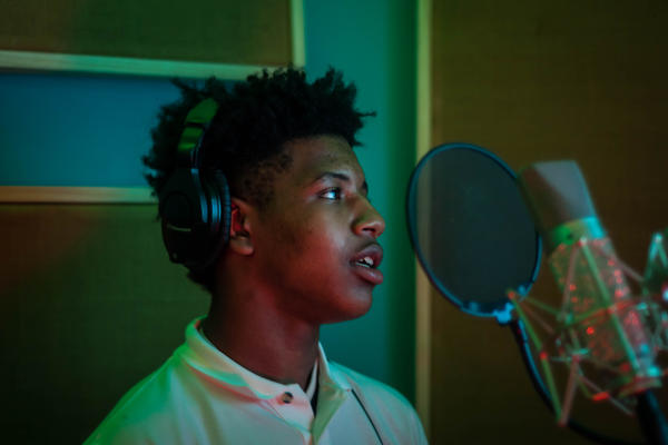 Arthur Ross is a freshman at Innovative Concept Academy and one of the finalists of the Mentors in Motion songwriting competition. Here he records the hook to a new song.