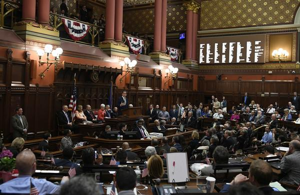 Connecticut Gov. Dannel P. Malloy addresses the House and the Senate as the legislative session ends at the State Capitol late Wednesday evening in Hartford, Conn.