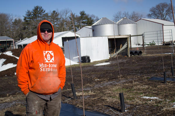 Corey Goodhue, who farms in Carlisle, Iowa, says crop insurance balances the financial risk his family takes each year. He stores some crops in the grain bins in hopes for a better price.