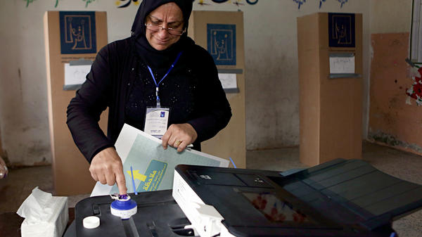 An Iraqi woman casts her vote in the country's parliamentary elections in Baghdad on Saturday.