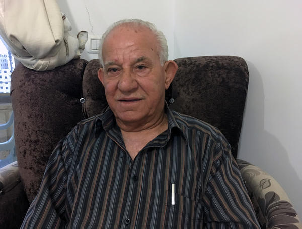 "Akram Tamimi, 79, moved to a neighborhood behind the barrier to maintain his Jerusalem residency rights, but calls it ""a prison."""