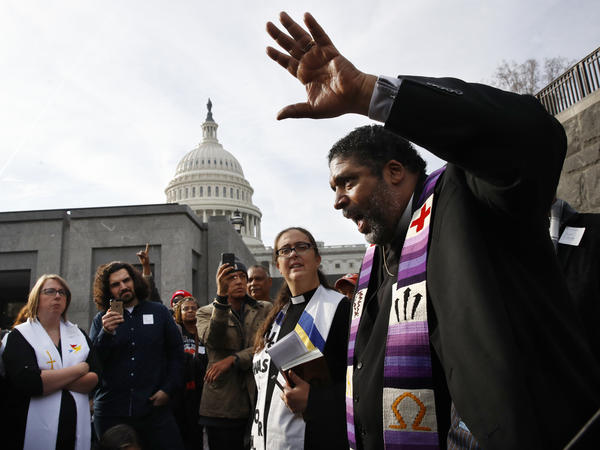 Rev. William Barber with the Poor People's Campaign speaks to a group after they prayed inside of the Capitol Rotunda in protest of the GOP tax overhaul in December.