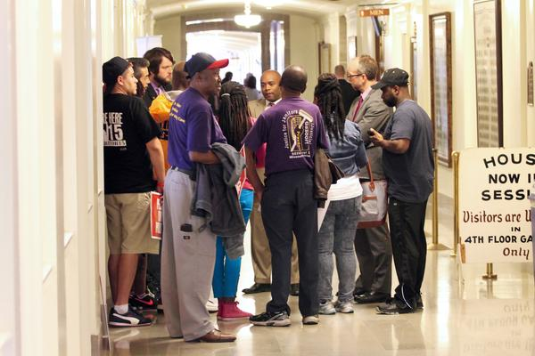 """A group of union officials speak with Rep. Courtney Curtis, D-Ferguson. Curtis sponsored a """"right to work"""" bill this year aimed at construction unions."""