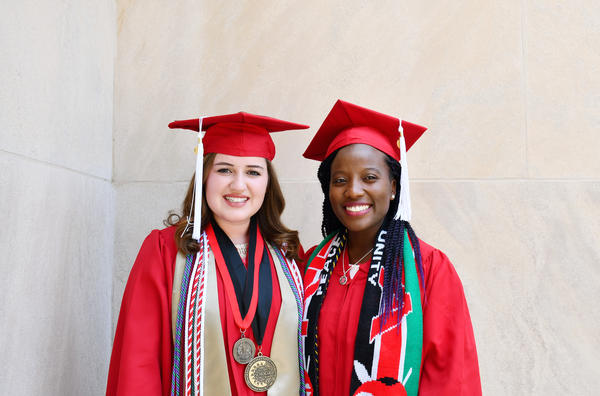 Cristina Chase Lane (left) and WinnieHope Mamboleo recently graduated from North Carolina State University's College of Education.