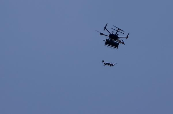 An Israeli drone drops tear gas canisters on Palestinian protesters during clashes with Israeli forces near the border between Israel and the Gaza strip.