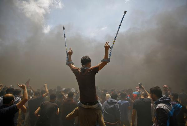 Palestinians protest near the border between Israel and the Gaza Strip.