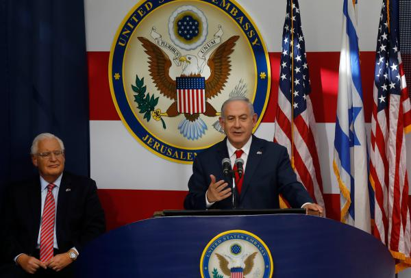 U.S. Ambassador to Israel David Friedman listens as Israel's Prime Minister Benjamin Netanyahu delivers a speech during the U.S. Embassy opening ceremony.