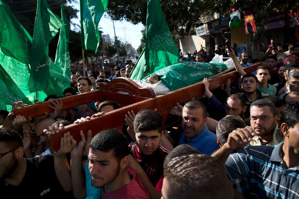 Palestinians carry the body of Mousab Abu Leila, 29, at his funeral after he was killed along the Gaza border during a protest against the U.S. move of its embassy to Jerusalem.