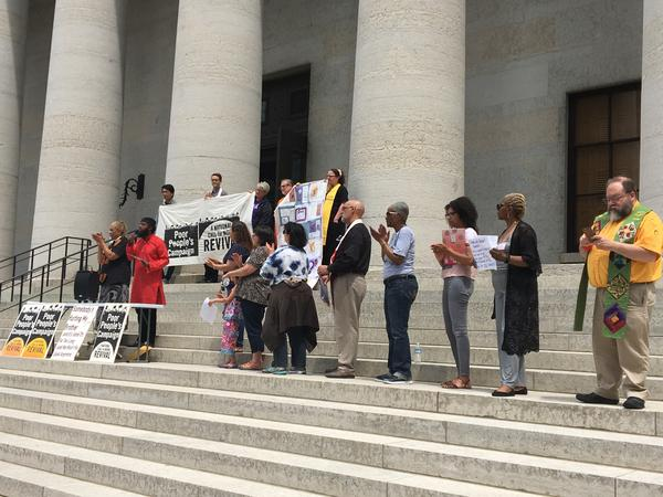 Leaders of rally stand on steps of Statehouse