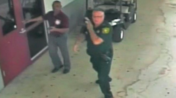 The Broward Sheriff's Office released an unedited of surveillance video outside Marjory Stoneman Douglas High School during and after confessed school shooter Nikolas Cruz killed 17 people on Feb. 14, 2018.