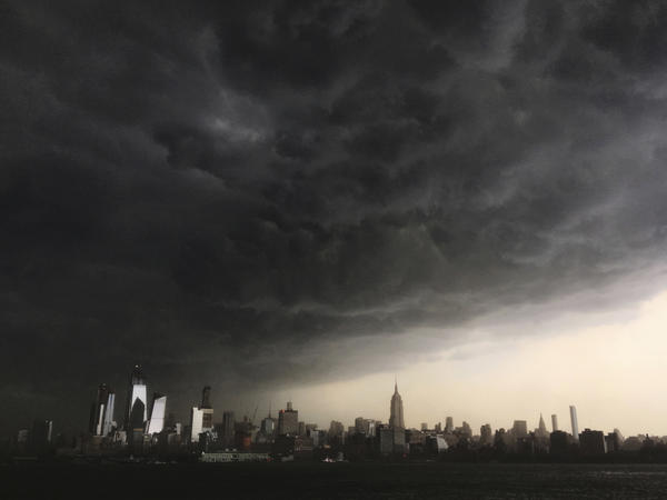 Storm clouds gathered over New York City on Tuesday as a line of strong storms pushed across much of the Northeast and Mid-Atlantic.