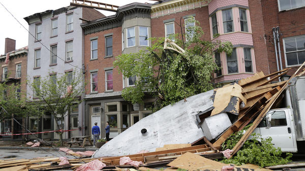 Severe weather left buildings damaged in Newburgh, N.Y., on Wednesday.